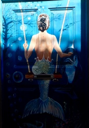 Swinging mermaid door