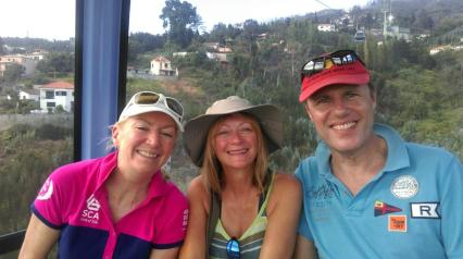 Riding the Funchal cable car (from left to right) Annie, Sally and Chris!