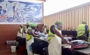 The fish market men descaling